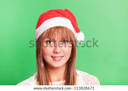 Cheerful Woman with Santa Hat on Green Background