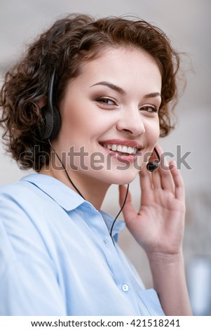 Cheerful woman working in the call center