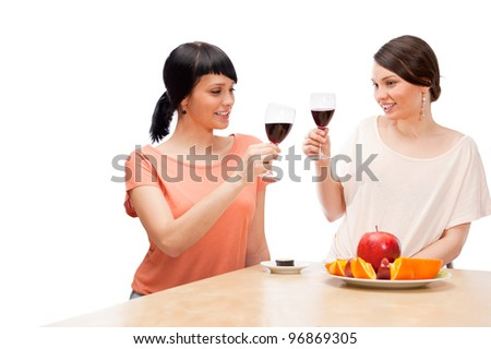 Cheerful Women eating fruits and drinking red wine