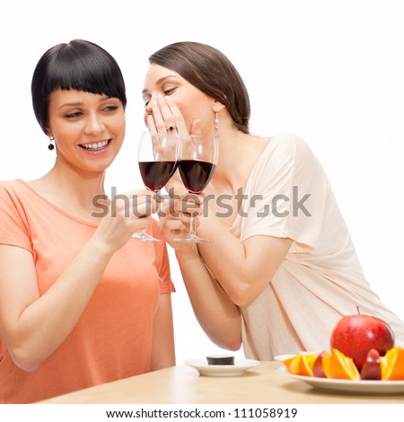 Cheerful Women eating sushi rolls and drinking red wine - stock photo
