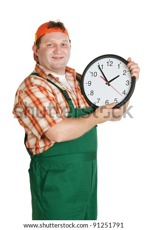 Cheerful worker with a big clock in the hands of a white background - stock photo
