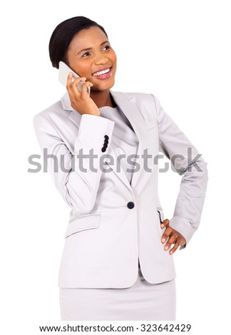 cheerful young african business woman talking on cell phone on white background - stock photo