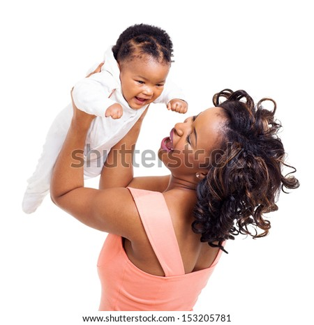 cheerful young african woman playing with her baby girl over white background - stock photo