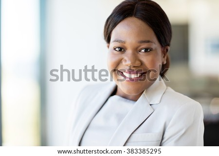 cheerful young afro american business executive in office - stock photo