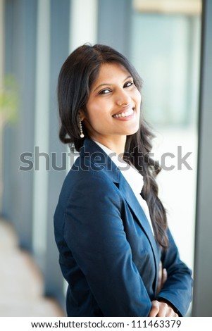 cheerful young asian businesswoman in office - stock photo