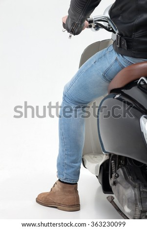 Cheerful young biker is driving the motorbike - stock photo