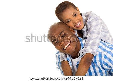 cheerful young black couple piggybacking on white