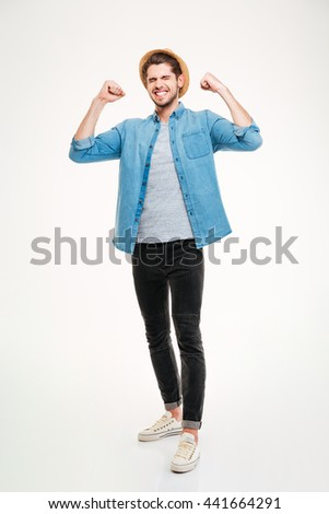 Cheerful young black man smiling and keeping arms raised while standing isolated on white background - stock photo
