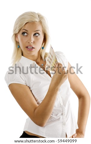 cheerful young blond lady holding 50 euro cash and looking on one side