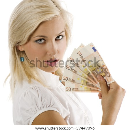 cheerful young blond lady holding euro cash and smiling - stock photo