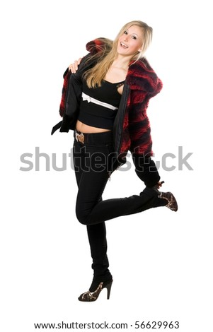 Cheerful young blond woman in a fur jacket. Isolated on white