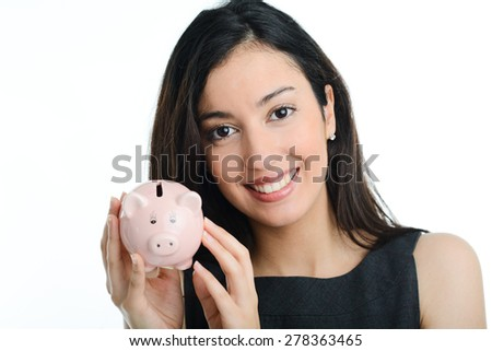 cheerful young brunette woman holding a piggy bank in her hands - stock photo
