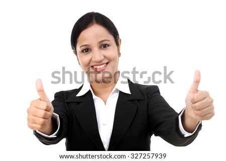 Cheerful young business woman showing thumb up by two hands - stock photo