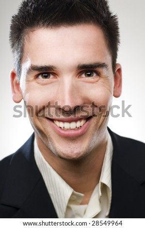 Cheerful young businessman close up portrait - stock photo