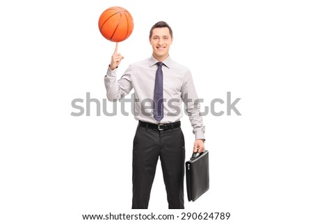 Cheerful young businessman holding a briefcase and spinning a basketball on his finger isolated on white background - stock photo