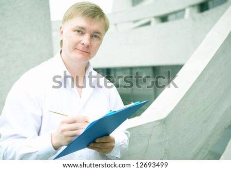 Cheerful young businessman on stairs