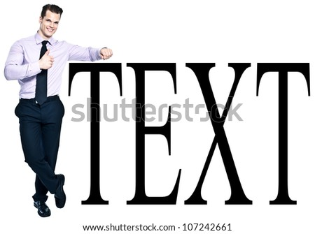 Cheerful young businessman showing thumb up while leaning against sample text - Add your own text here - stock photo