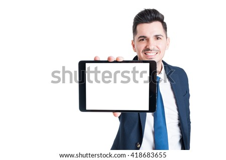 Cheerful young businessman shows the screen of modern tablet in close up with copyspace isolated on white background - stock photo