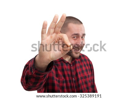 Cheerful young businessman with okay gesture, against white background - stock photo