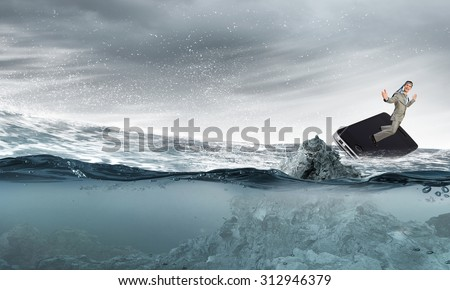 Cheerful young businessman with tie around head floating in water on mobile phone - stock photo