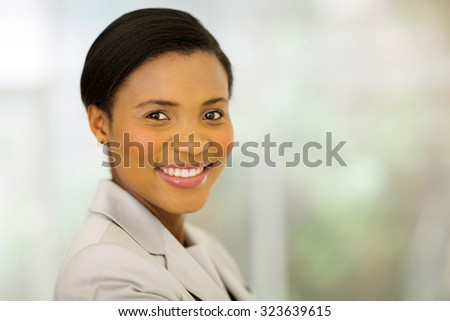 cheerful young businesswoman in modern office - stock photo