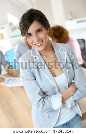 Cheerful young businesswoman in work meeting