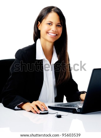 cheerful young businesswoman working at her computer isolated on white - stock photo