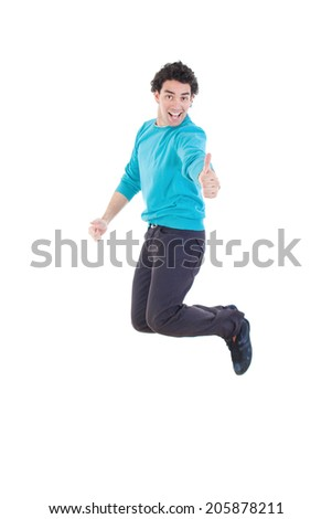 Cheerful young casual man jumping in air showing thumb up smiling, Excited modern handsome man jumping out of joy full of energy like winner - stock photo