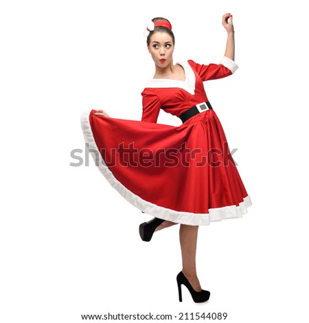 cheerful young caucasian woman in red vintage clothing dancing isolated on white