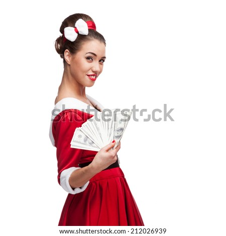 cheerful young caucasian woman in red vintage clothing holding money isolated on white - stock photo