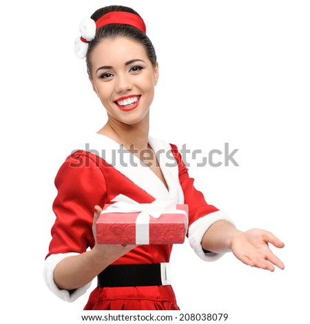 cheerful young caucasian woman in red vintage clothing holding red christmas gift isolated on white - stock photo