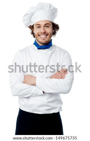 Cheerful young cook posing confidently over white - stock photo
