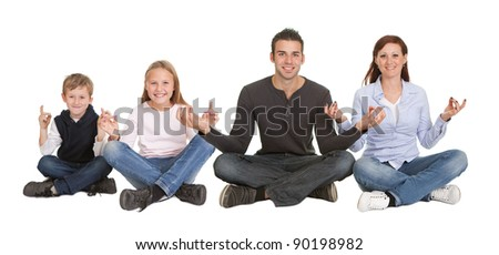 Cheerful young couple doing yoga exercise. Isolated on white - stock photo