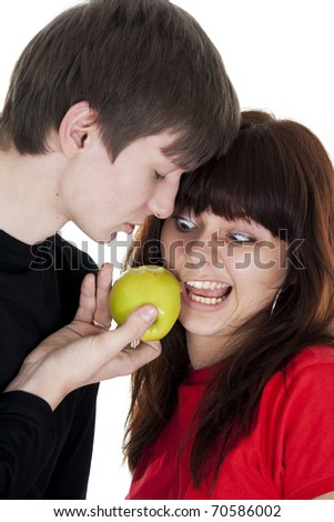 cheerful young couple eats one green apple