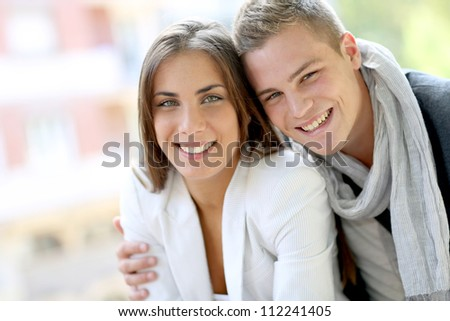 Cheerful young couple in town - stock photo