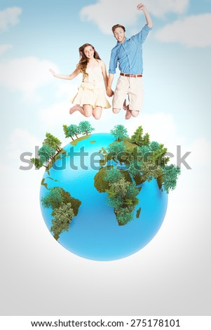 Cheerful young couple jumping against blue sky - stock photo