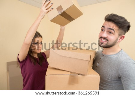 Cheerful young couple moving in their new home