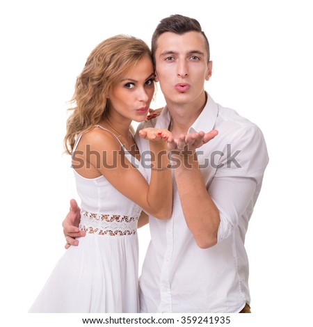 Cheerful young couple on white background, isolated - stock photo