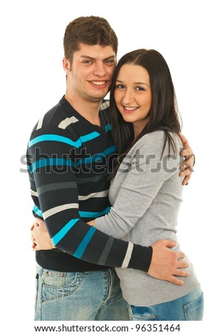 Cheerful young couple standing in embrace isolated on white background