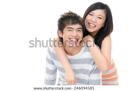 Cheerful young couple standing on white background - stock photo