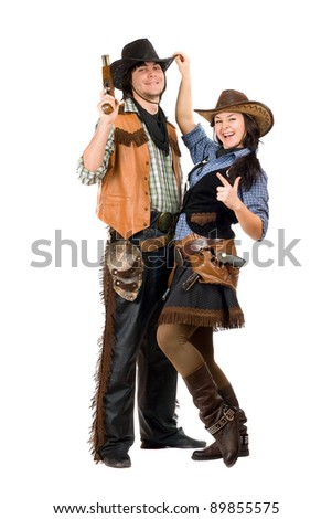 Cheerful young cowboy and cowgirl. Isolated on white - stock photo