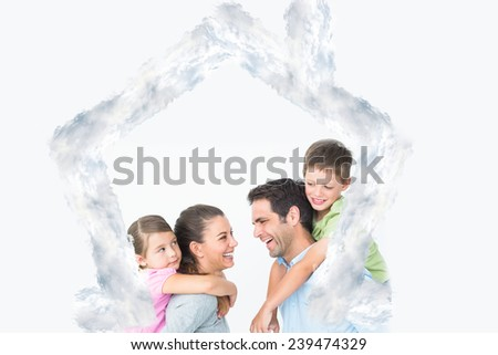 Cheerful young family posing against house outline in clouds - stock photo