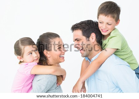 Cheerful young family posing on white background - stock photo