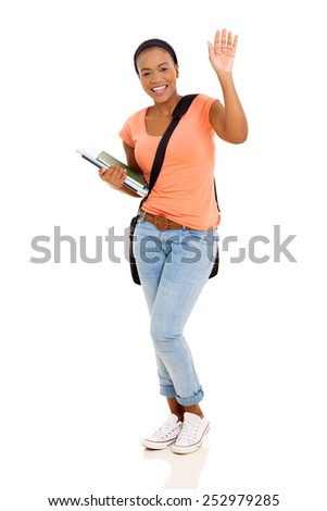 cheerful young female african american college student waving goodbye isolated on white - stock photo