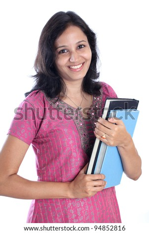Cheerful young female student holding books - stock photo