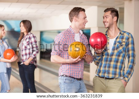 Cheerful young friends are making fun together - stock photo