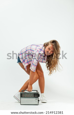 cheerful young girl climbs a radio studio - stock photo