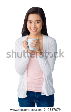 Cheerful young girl with a cup of tea or coffee - stock photo