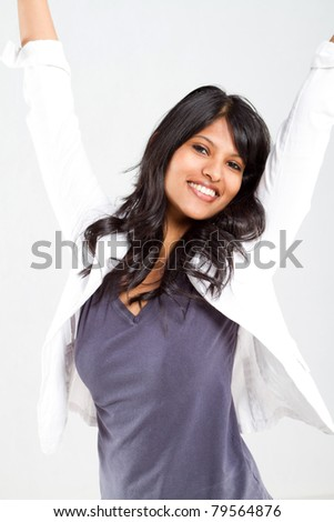 cheerful young indian woman portrait over white - stock photo