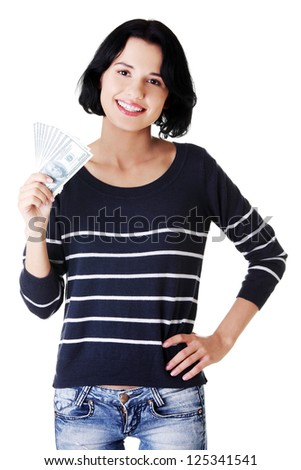 Cheerful young lady holding cash - dollars USD - stock photo